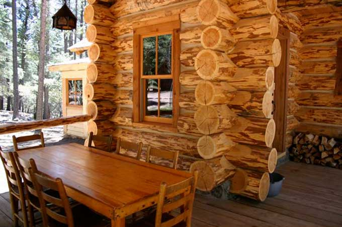 Log cabin porch with outdoor dining room