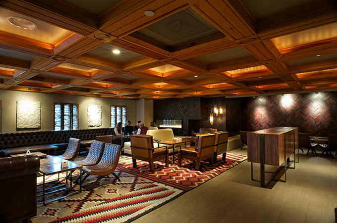 Rich leather wall and wood ceiling details